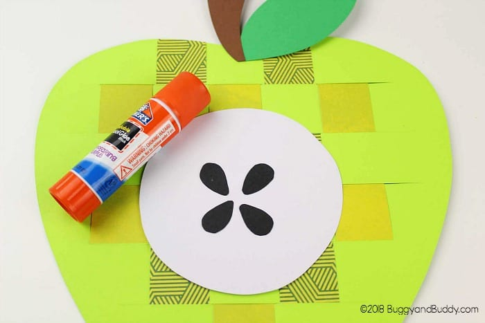 glue the core, stem and leaf onto your paper apple craft