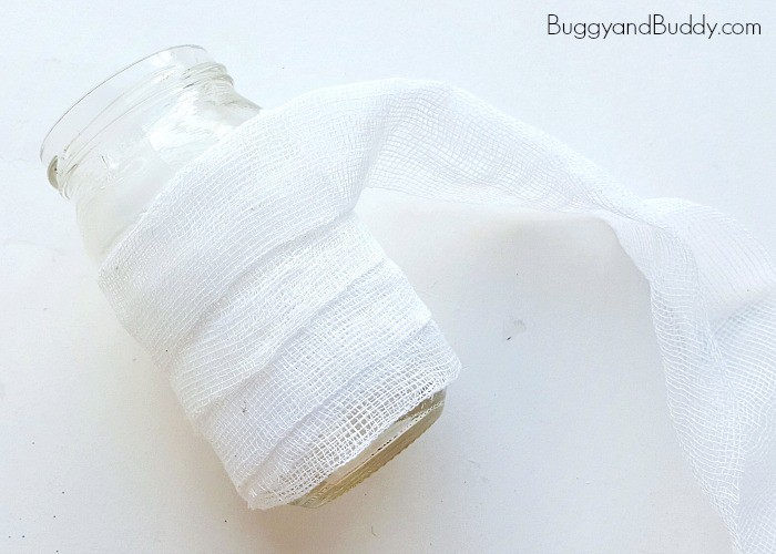 continue wrapping the gauze around your jar to make your mummy or ghost lantern craft