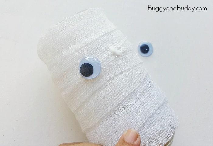 Glue googly eyes to your mummy craft