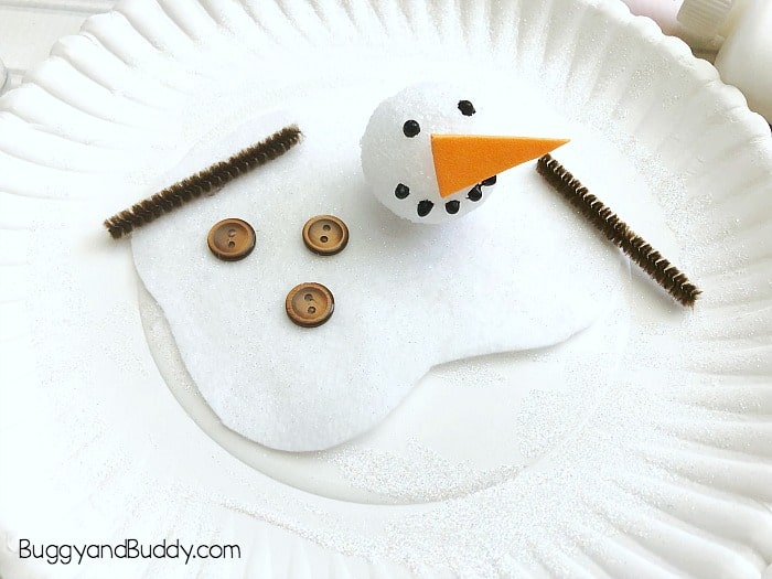 add some buttons and arms to your melted snowman